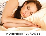 young woman lying in bed | Shutterstock . vector #87724366