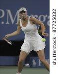 NEW YORK - SEPTEMBER 01: Caroline Wozniacki of Denmark returns ball during 2nd round match against Arantxa Rus of the Netherlands at USTA Billie Jean King National Tennis Center on Sept. 01, 2011 in New York City, NY. - stock photo