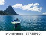 A Small Blue Boat On A Beach I...