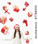 Christmas Santa woman - raining gifts and falling presents. Asian woman in santa hat excited isolated on white background. - stock photo