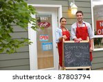 cafe owners in front of shop | Shutterstock . vector #87803794
