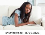 young woman lying on the sofa... | Shutterstock . vector #87932821