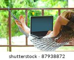 Young Woman Sitting In A...