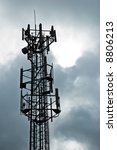 Radio pylon/mast against a sinister sky background - stock photo