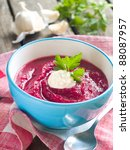 Beet cream soup with garlic and sour cream, selective focus - stock photo