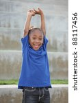 Boy smiling and stretching his arms - stock photo