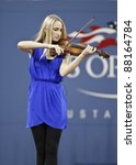 NEW YORK - AUGUST 29: Jane Hunt Violin Venus performs during opening ceremony at USTA Billie Jean King National Tennis Center on August 29, 2011 in NYC - stock photo