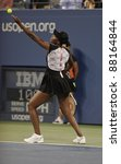 NEW YORK - AUGUST 29: Venus Williams of USA returns ball during 1st round match against Vesna Dolonts of Russia at USTA Billie Jean King National Tennis Center on August 29, 2011 in NYC - stock photo
