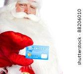 Traditional Santa Claus Holdin...