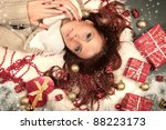 beautiful frozen woman with presents - stock photo
