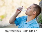young man drinking bottled... | Shutterstock . vector #88413517