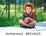 Portrait of a little boy in summer forest - stock photo