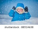 Portrait of a little boy playing outdoors in the snow - stock photo
