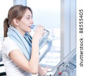 young woman at the gym... | Shutterstock . vector #88555405
