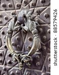 Small photo of Bronze antique drawer door handle on a Agha Bozorg mosque, Kashan, Iran
