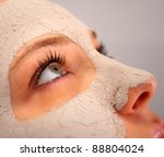 Close up of a spa clay mask on a woman's face - stock photo