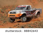 BLOEMFONTEIN, SOUTH AFRICA - OCTOBER 15: Jannie Visser and Joks le Roux in their Toyota Hilux in action during a South African off road championship event, Bloemfontein, South Africa, 15 October 2011 - stock photo