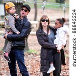 BUDAPEST - NOVEMBER 5: Brad Pitt and Angelina Jolie take their children Pax, Zahara and Shiloh to a park in Budapest, Hungary, on Friday,  November 5, 2010.  Jolie is filming In The Land Of Blood And Honey In Budapest. - stock photo