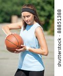 young woman with basketball...   Shutterstock . vector #88851388