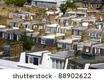 Rows of typical London terraced housing rooftops - stock photo