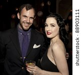 NEW YORK - NOVEMBER 15: DITA VON TEESE & GUEST CELEBRATE U.S. LAUNCH OF HER NEW TRAVEL ACCESSORY MY COINTREAU TRAVEL ESSENTIALS AT FORTY FOUR ROYALTON on November 15, 2011 in NYC - stock photo