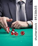 Man in suit rolling dices - stock photo