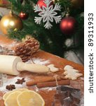 Christmas baking, Christmas tree in the background. - stock photo