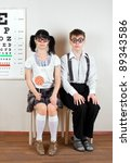 Two person wearing spectacles in an office at the doctor - stock photo