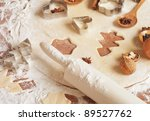 Baking christmas cookies with star and tree motif - stock photo