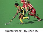 BLOEMFONTEIN, SOUTH AFRICA - FEBRUARY 8: Leslie-Ann George (L) and Emilie Sinia (R) during a womens field hockey match between South Africa and Belgium, Bloemfontein, South Africa, 8 February 2011 - stock photo