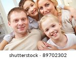 close up of a smiling family of ... | Shutterstock . vector #89702302