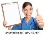 Nurse Showing Blank Clipboard...