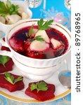 red borscht (barszczyk) with ravioli (uszka) for traditional christmas eve dinner - stock photo