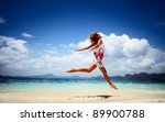 young woman jumping on a beach | Shutterstock . vector #89900788