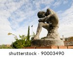 Spinario sculpture, Boy removing a spine from his foot in Granada, Andalusia, Spain - stock photo
