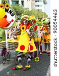 LIMASSOL,CPRUS-MARCH 3, 2011: Unidentified women in clown costumes  during the carnival parade. - stock photo