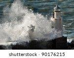 Waves Breaking Against A...