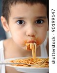 Eating spaghetti - stock photo