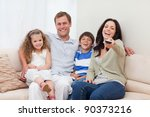 young family watching comedy... | Shutterstock . vector #90373216