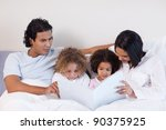 young parents reading a book... | Shutterstock . vector #90375925