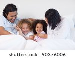 smiling young family sitting on ... | Shutterstock . vector #90376006
