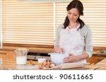 Happy Woman Baking In Her...