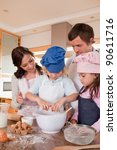 portrait of a family baking in... | Shutterstock . vector #90611716