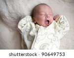picture of a newborn baby yawns - stock photo