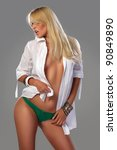 Attractive blonde girl in green underwear and provocative white shirt, posing - stock photo