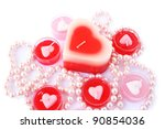Heart shape red and pink candles with necklace  isolated on white background. - stock photo