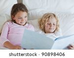 brother and sister reading bed...   Shutterstock . vector #90898406