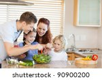 young family preparing salad... | Shutterstock . vector #90900200
