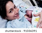 beautiful new mother happy... | Shutterstock . vector #91036391