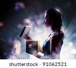 silhouette of a woman on a background of lights - stock photo